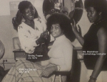 Shirley receives approval from Ms. Blackshear for last touches on Priscilla huge afro (hair).