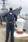 CMDCM(SW/AW) Anthony T. Smith standing in front of the 'ADMIRAL DESTROYER'  USS ARLEIGH BURKE's CMC from  JUN 2007- M